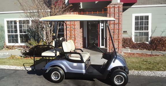 Blue golf cart in front of building